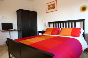 camera-girasole-letto